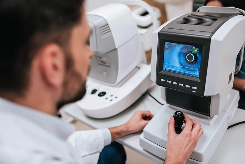 Doctor looking at a digital scan of a patients eye