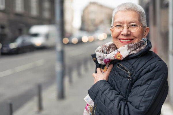 mature woman wearing glasses and scarf