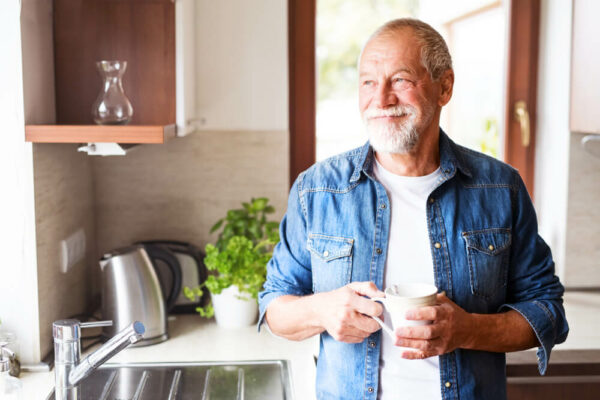 mature man drinking a cup of coffee