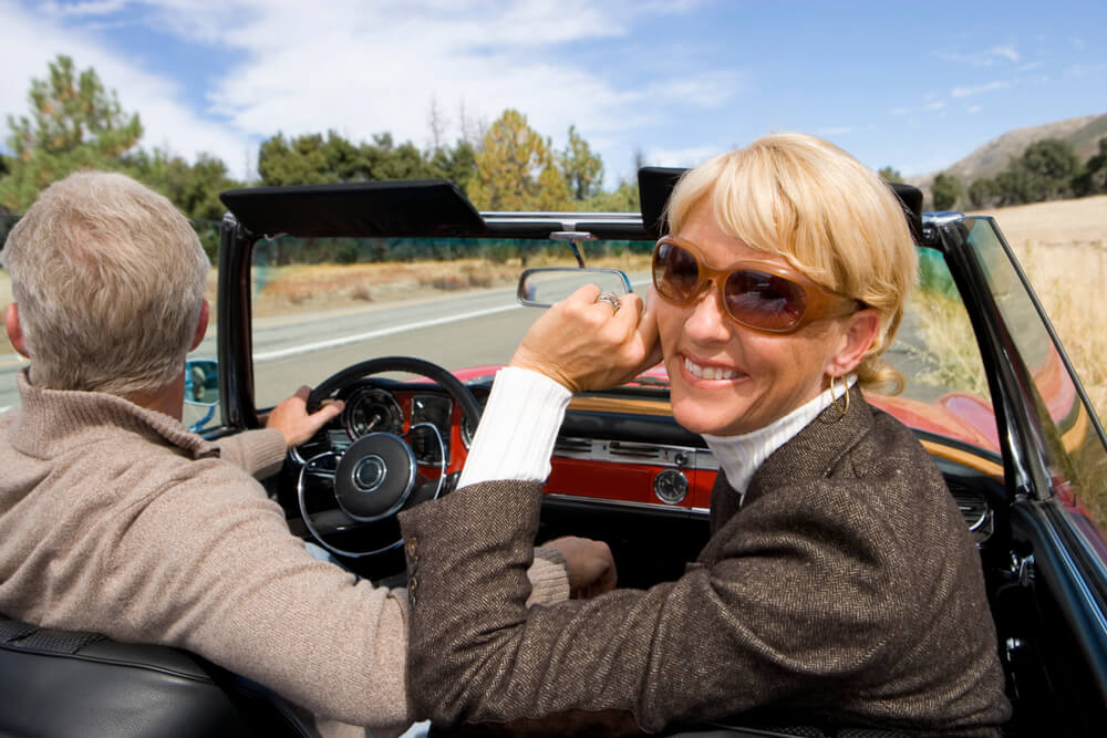 woman in sunglasses in convertable